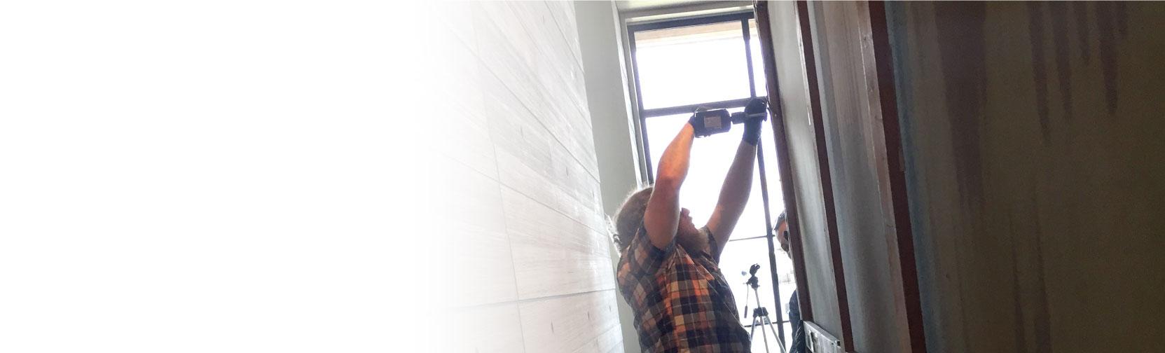 Art Installation Services - Man installing art piece