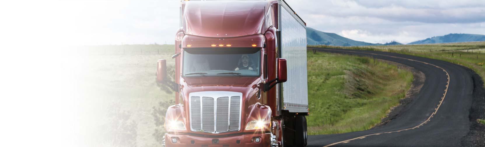 Art transportation services - truck on a highway - Art Work Fine Art Services